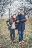 Couple in love using tablet connecting web wireless wifi Stock Image