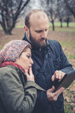 Couple in love using tablet connecting web wireless wifi Stock Images