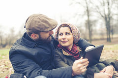 Couple in love using tablet connecting web wireless wifi Stock Photography