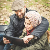 Couple in love using tablet connecting web wireless wifi Royalty Free Stock Photos