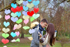 Couple in love on Valentine's Day in the Park with hearts.  Royalty Free Stock Photos