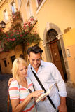 Couple in love visiting an old street of Rome royalty free stock image