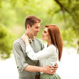 Couple in love walk near the river, smiling. Stock Photo