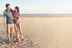 couple in love walking along the beach Stock Photos