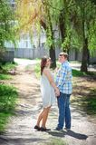 Couple in love walking along the path Stock Photos