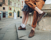 Couple in love are walking around the city in sunny morning stock photography