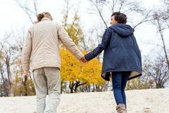 Couple in love are walking in the autumn park. Afroamerican girl with a European.  stock photography