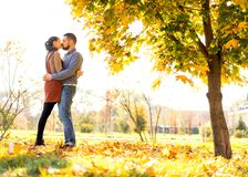 Couple in love walking in autumn park royalty free stock photo