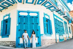 Guy and girl walking through the beautiful streets royalty free stock image