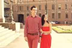 Couple in love walking in city Stock Photo