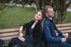 Couple in love. Couple walking through the city, sitting on the bench, photographed and drinking coffee Royalty Free Stock Photo