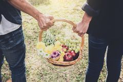 Couple in love walking and holding a picnic basket on nature out stock photo