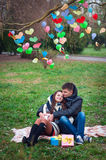 Couple in love walking outdoors in autumn in the park, decorated Royalty Free Stock Image