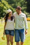 Couple in love walking outdoors Stock Images