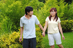 Couple in Love walking through the park stock photo