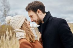 Couple in love walking in the Park, Valentine`s day. A man and a woman embrace and kiss, a couple in love, tender feelings Stock Photography