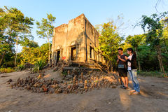 Couple Love walking for pray around old temple of WadSomDed Kao. Kanchanaburi , Thailand - Feb 5, 2017 : Couple Love walking for pray around old temple of Stock Photo