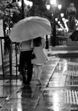 Couple in love walking in the rain Stock Photo