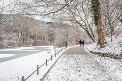 Couple in love walking in the snow. By the river in Berlin, Germany Stock Photos