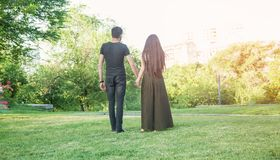 Couple in love walking in summer park stock photography