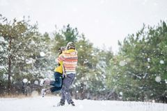 Couple in the winter park Stock Images