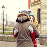 Couple in love walking in winter park and enjoy each other`s company Stock Images