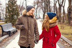 Couple in love walking in winter park and enjoy each other`s company Royalty Free Stock Photography