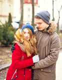 Couple in love walking in winter park and enjoy each other`s company Stock Photo