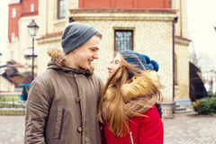 Couple in love walking in winter park and enjoy each other`s company Stock Image