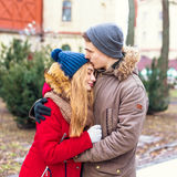 Couple in love walking in winter park and enjoy each other`s company Royalty Free Stock Photos