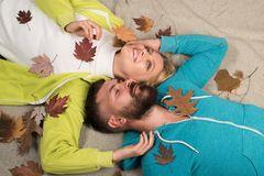 Couple in Love wearing in fashionable seasonal clothes having Autumnal mood. Fashion portrait of beautiful sensual. Couple with leaves on autumn background royalty free stock photos