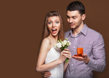 Couple in love  with wedding ring and gift box Royalty Free Stock Photography