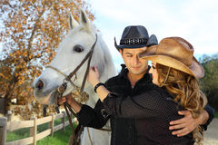 Couple in love with a white horse Royalty Free Stock Photo