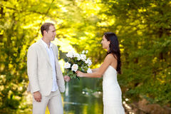 Couple in love with white roses bouquet Royalty Free Stock Photo