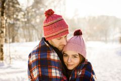Couple in love winter forest portrait. Snow close up Stock Photo