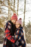 Couple in love winter forest. Sight Stock Images