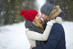 Couple in love in winter scenery Stock Images