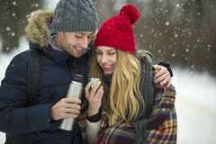 Couple in love in winter scenery Stock Photography