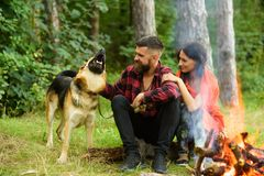 Couple in love, young happy family spend leisure with dog. Stock Image