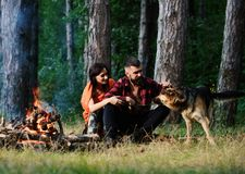 Couple in love or young happy family spend time together. Woman, men and dog on vacation, hiking. Family defender concept. Couple with german shepherd dog on stock image