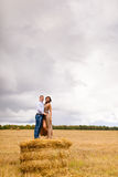 Couple in love young people resting on the haystack Royalty Free Stock Photography