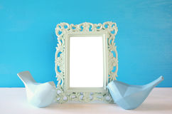 Couple of Lovebirds and blank photo frame Royalty Free Stock Image
