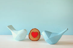 Couple of Lovebirds on wooden table.  Stock Photo