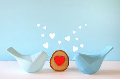 Couple of Lovebirds on wooden table Royalty Free Stock Image