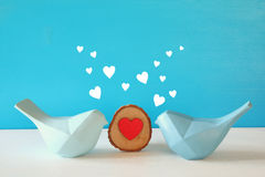 Couple of Lovebirds on wooden table Stock Photo