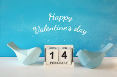 Couple of Lovebirds on wooden table Stock Images