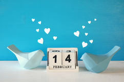 Couple of Lovebirds on wooden table Royalty Free Stock Photography