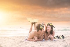 Couple lover enjoy honeymoon and long vacation on the sea beach,. Siiting on the swing together relax and confortable, valentine occasion Stock Photo