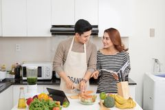 Couple lover enjoy together cooking in home kitchen, joining prepare food together for extent relationship last longer concept royalty free stock photos