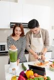 Couple lover enjoy together cooking in home kitchen, joining prepare food together for extent relationship last longer concept.  stock photo